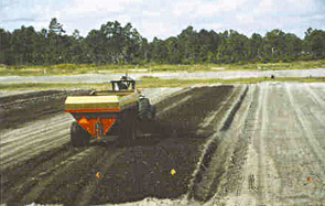 manure spreader applying compost