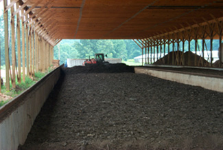 Figure 12. Bin   composting of chicken litter and yard waste. The final product is a less   bulky material that, when added to the soil, improves the soil quality.