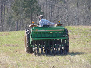 Example of sod-seeding with a no-till drill attached to tractor
