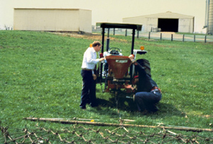Example of sod-seeding by broadcasting and dragging. Chain drag attached to tractor.