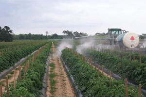 photo of hydraulic boom sprayer.