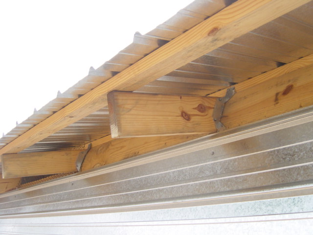 "Figure 24. Trusses tied to the top of a wall using ""hurricane straps?"