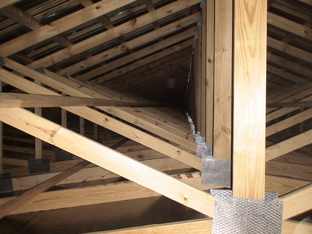 Figure 25. Bracing of trusses is essential to keep trusses vertical and to help carry loads along the length of the house
