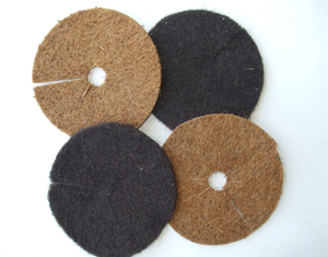 Figure 1. Permeable disk-type mulches composed of coconut fiber (upper left and lower right) and hair (upper right and lower left).