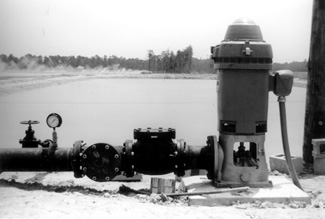 photo of a large agricultural well with electric motor.