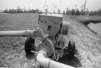 Photo of a iesel powered pumping unit on pond.