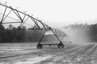 photo of center pivot irrigation system with medium pressure impact sprinklers.