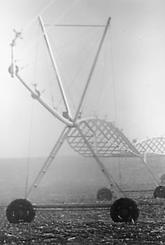 Photo of center pivot irrigation system with high pressure impact sprinklers and end gun.