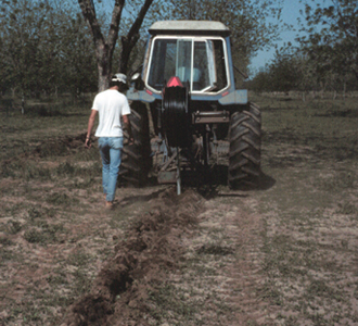Figure 14. Installing lateral line using subsoil plow.