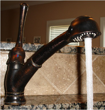 Photo of a kitchen faucet with running water