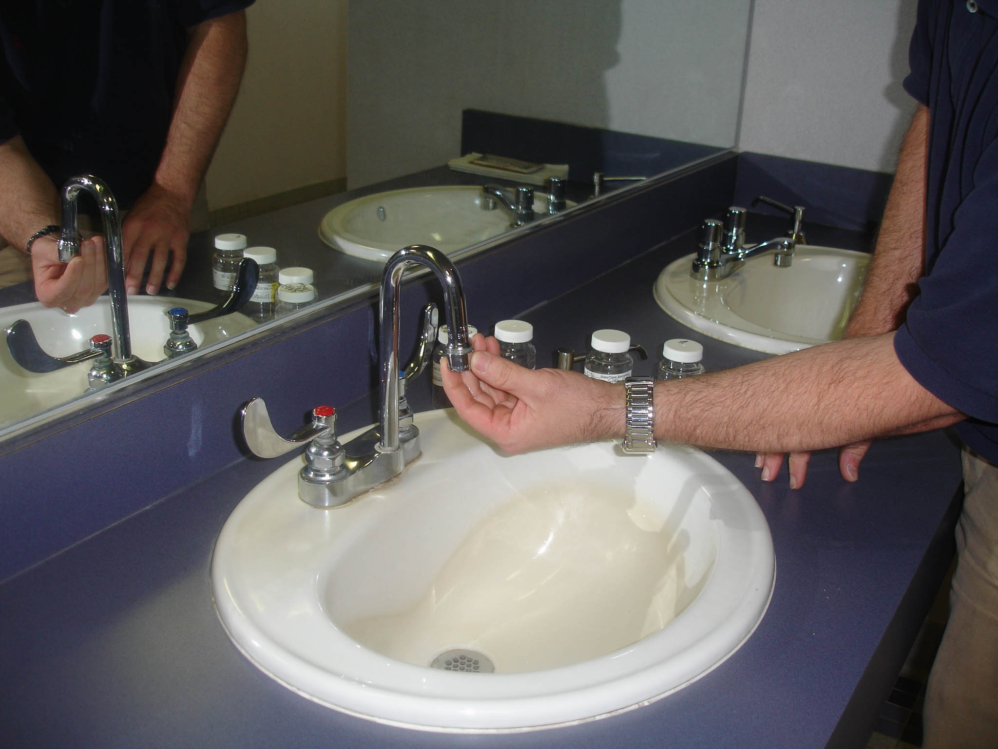 Photo showing the removal of aerator from sink faucet