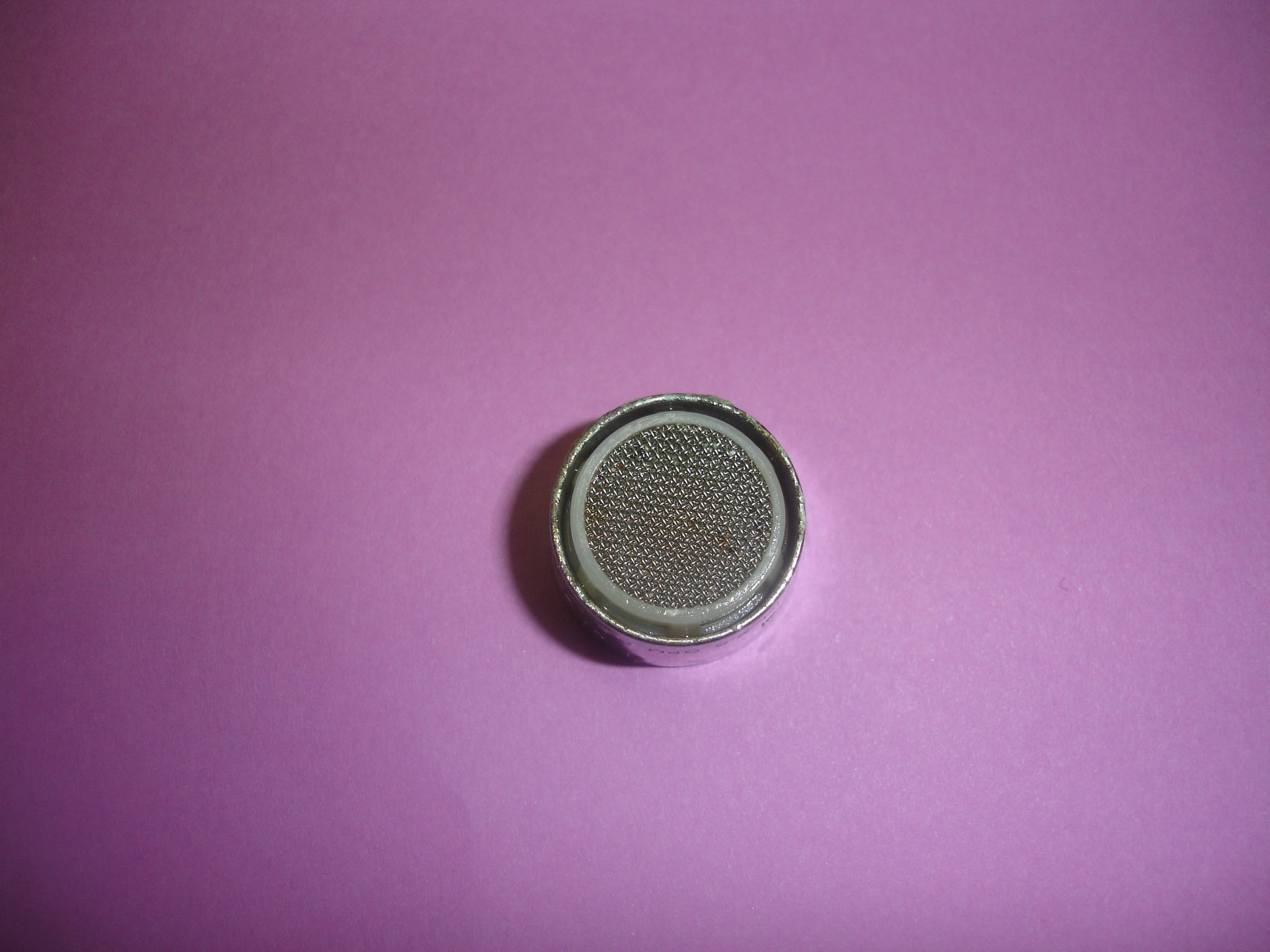 Close-up photo of the faucet aerator after being removed