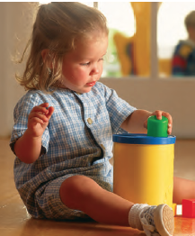 girl toddler playing with toy (stock photo)