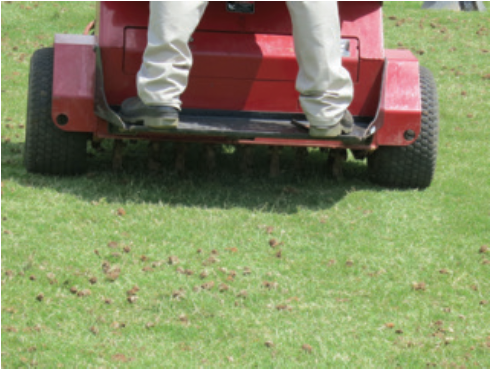 core aerator machine on grass
