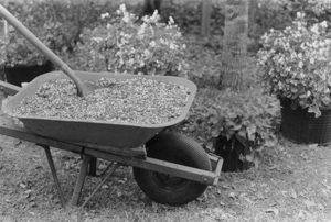 Figure 4. Soil can be mixed in garden wheelbarrows. Medium-size wheelbarrows hold approximately 4.5 cubic feet.