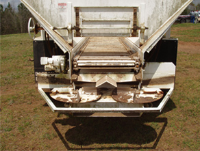 Back view of typical twin-disk spinner manure spreader truck.