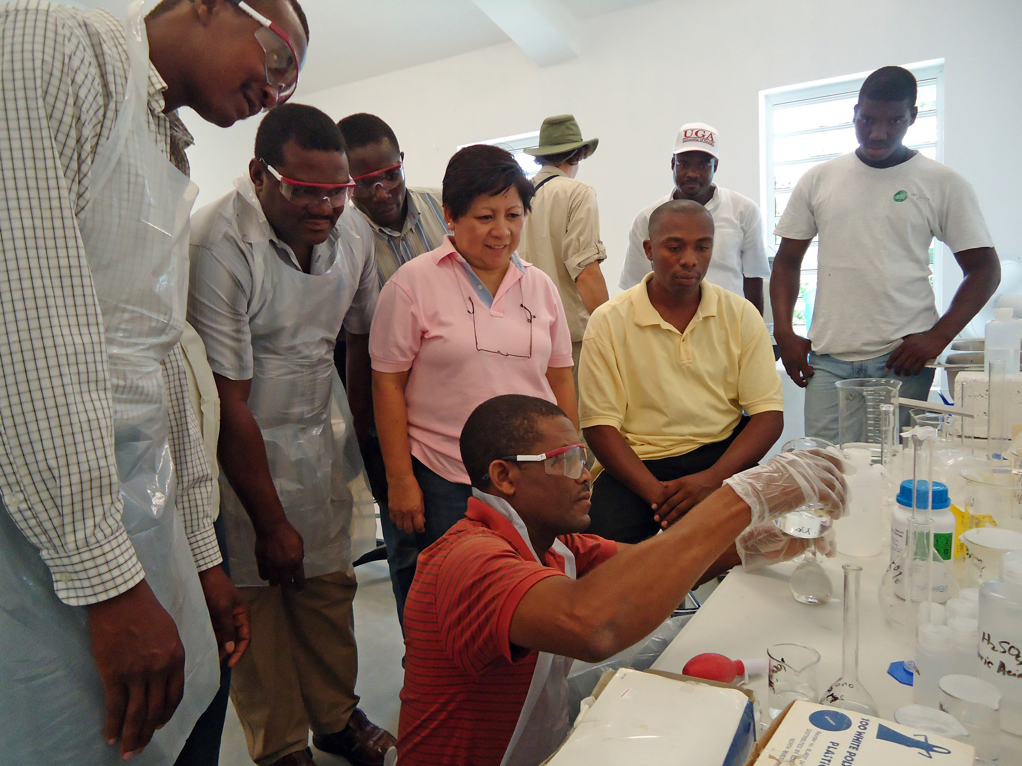 Leticia Sonon, coordinator of the University of Georgia Extension Soil, Plant and Water Analysis Laboratory, teaches a group of Haitian teachers and school officials to use the soil-testing lab equipment that they recently delivered to the country.  Sonon, and Agricultural and Environmental Services Laboratory director David Kissel, spent about a year design the lab, which is compact, durable and inexpensive to operate.