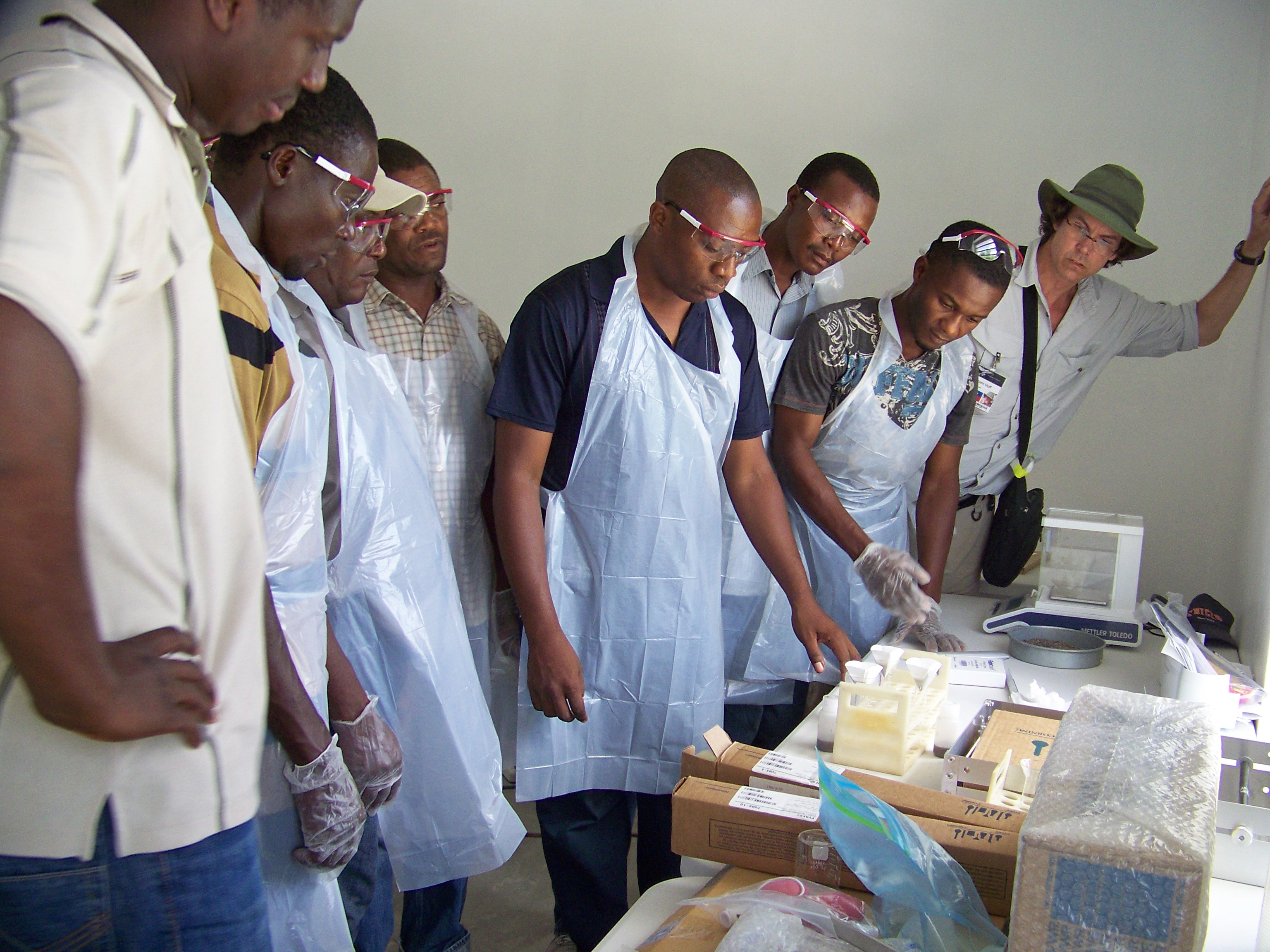 Graham Huff, coordinator of Atlanta-basednonprofit League of Hope, watches as group of Hatian teachers and school officials go through a battery of tests in the new soil-testing lab. The lab is the only working soil lab in Haiti.