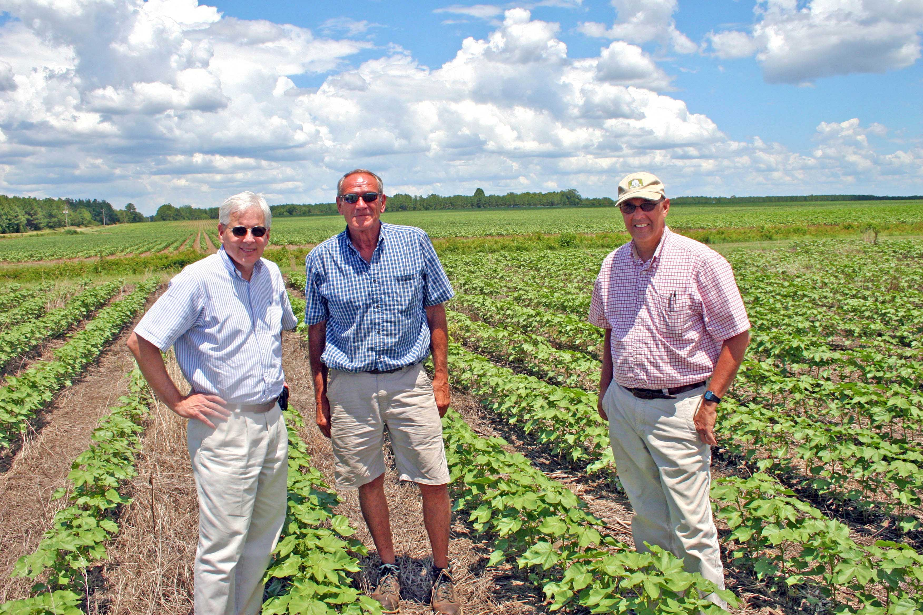 Scott Angle, dean of the UGA College of Agriculture and Environmental Sciences, Barry Martin, and Ronnie Barentine, County Extension Coordinator for Pulaski County. Angle and Barentine visited Martin's farm near Hawkinsville after Martin was named the 2012 Swisher Sweets/Sunbelt Expo Farmer of the Year.