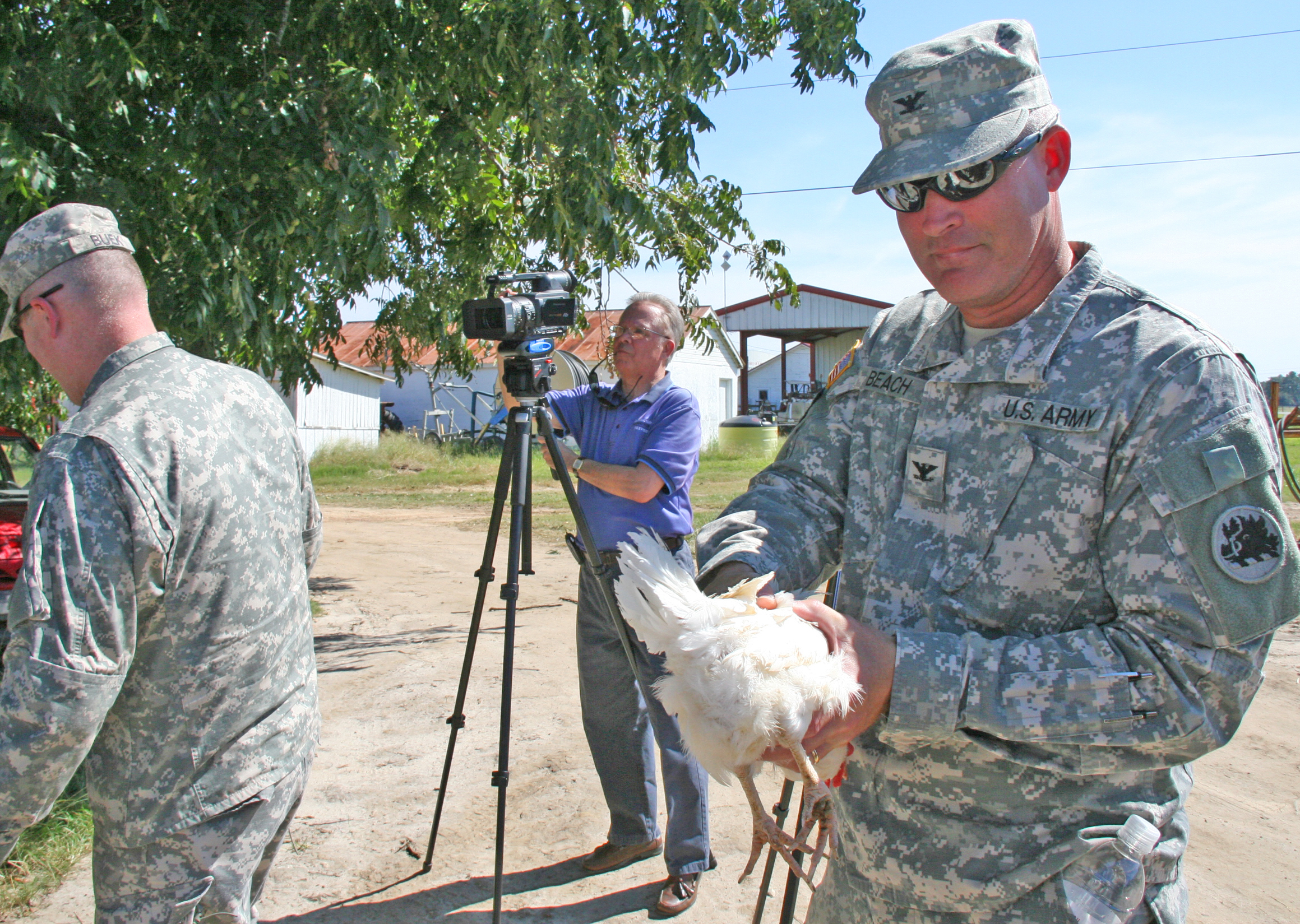Georgia National Guard Col. Barry Beach gets comfortable holding a chicken as his unit Agribusiness Development Team III trains in Tifton ahead of their deployment to Afghanistan.