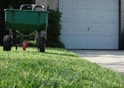 Lawn being fertilized