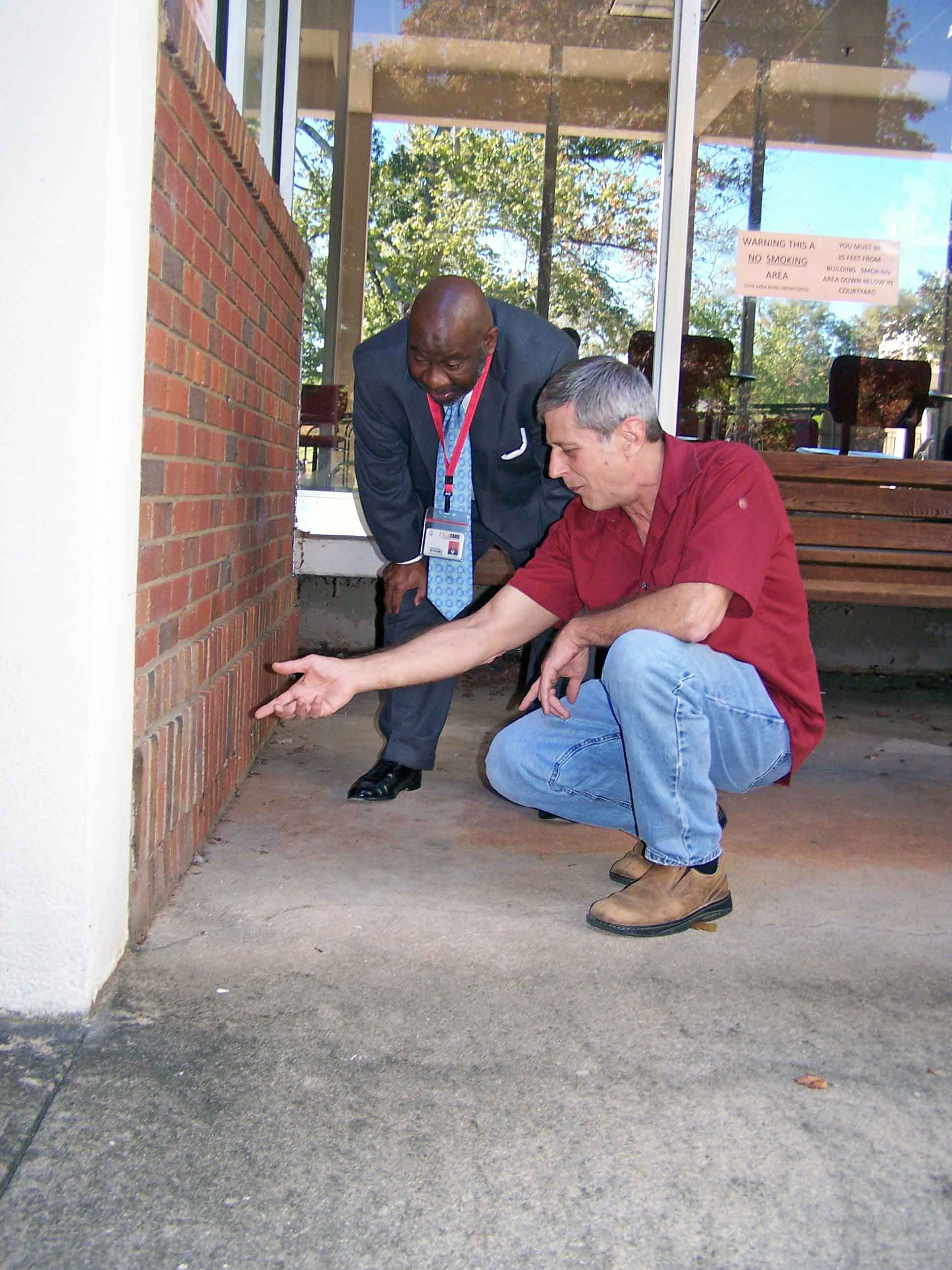 UGA College of Agricultural and Environmental Sciences entomologist Brian Forschler shows  Dexter Fisher, director of services for UGA Facilities Management, the spot in a wall at the Biological Sciences Building where termites made entry and started to swarm in an office.