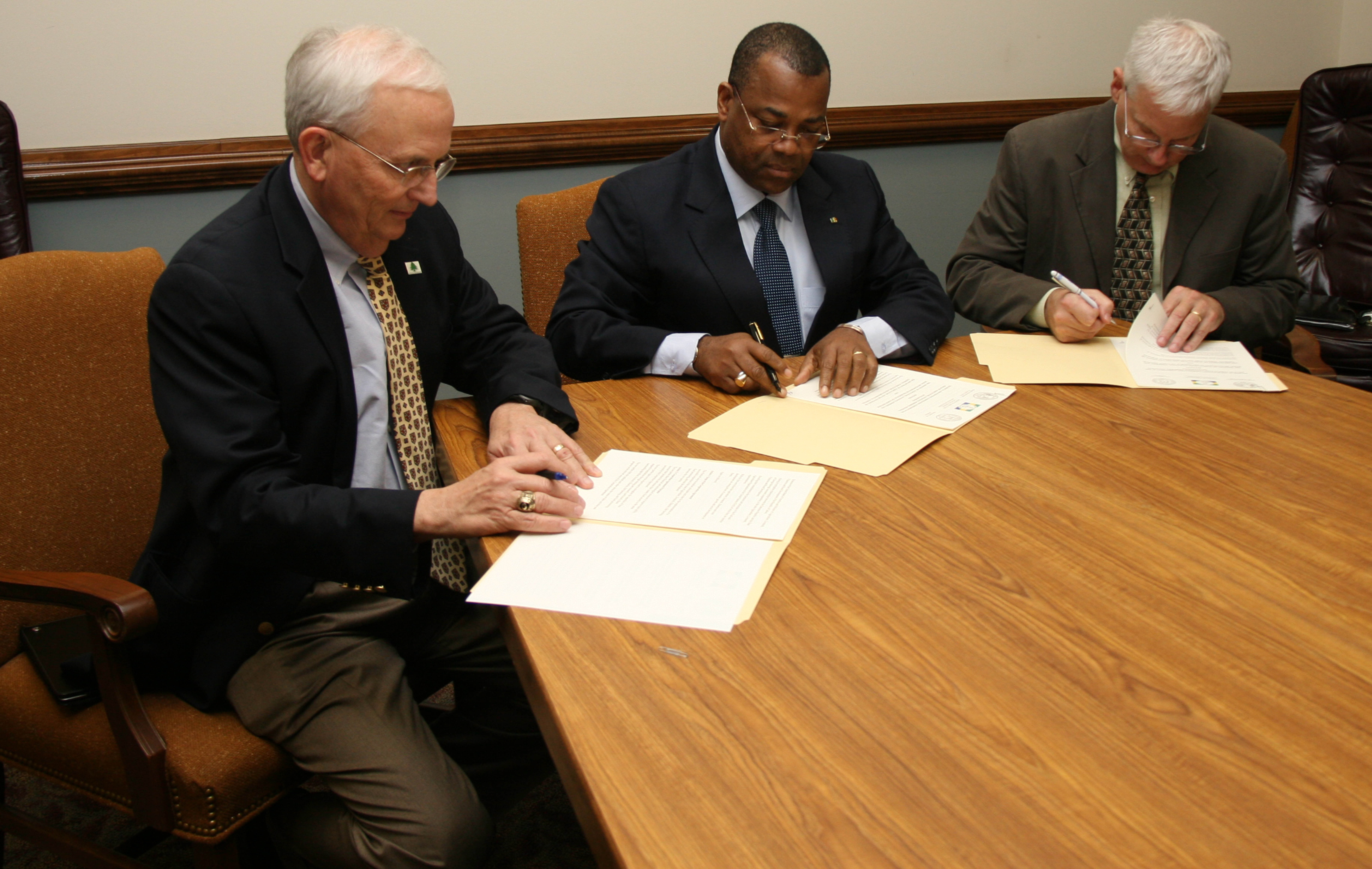 Georgia Commissioner of Agriculture Gary Black, Gabon's Minister of Agriculture, Livestock Fisheries and Rural Development, Julien Nkoghe-Bekale and UGA College of Agriculture and Environmental Sciences Dean J. Scott Angle sign an agreement promising future cooperation on agricultural development projects on Nov. 20.