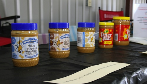 Jars of peanut butter await taste testers in the University of Georgia building at the 2012 Sunbelt Agricultural Expo.