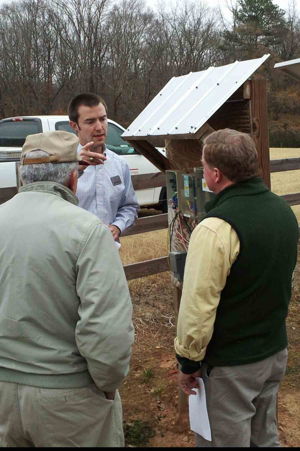 Madison County Extension Agent Adam Speir talks to cattle farmers at recent field day demonstrating a solar-powered wells for cattle.