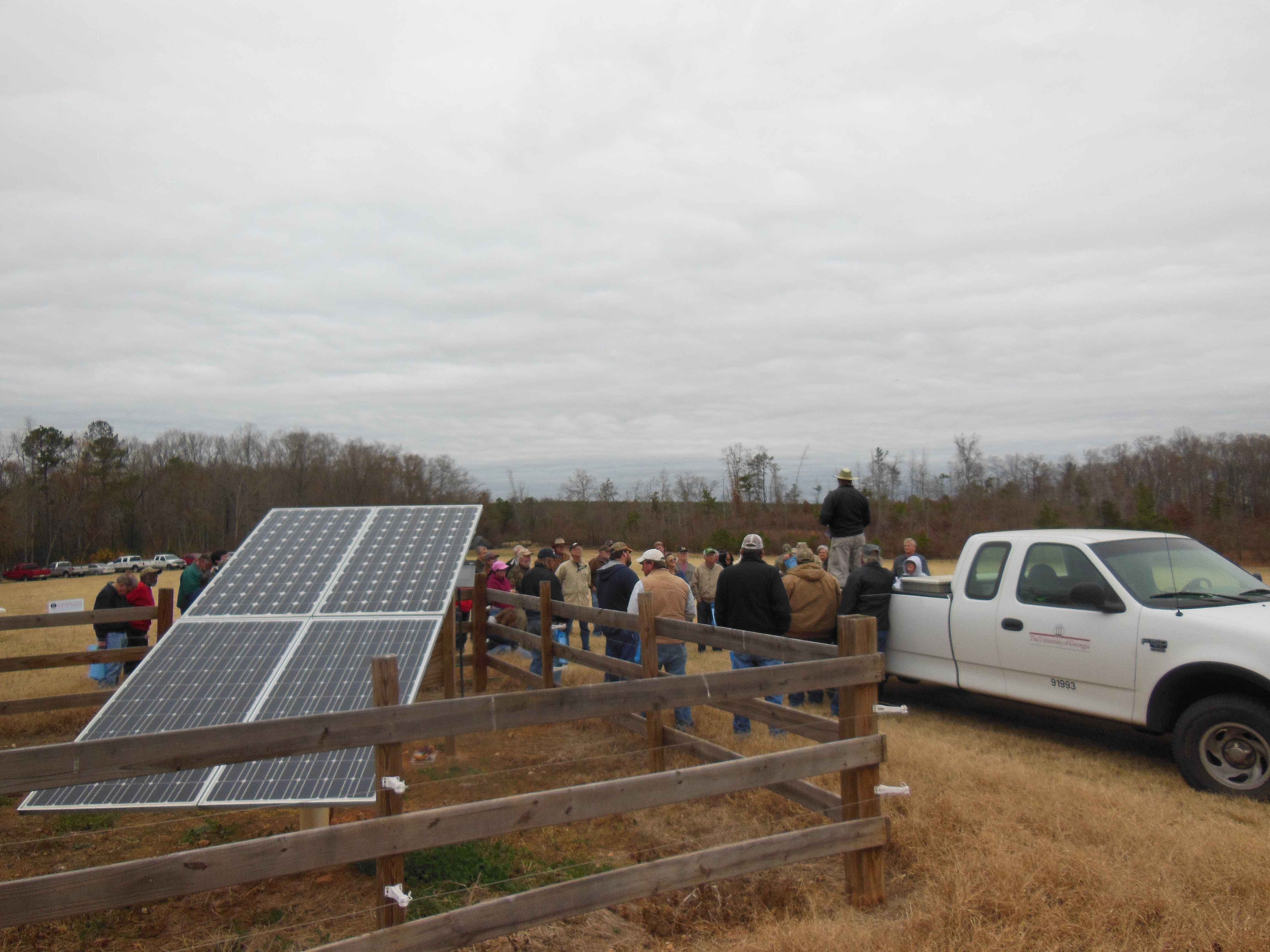 Gary Hawkins, the UGA College of Agriculture and Environmental Sciences Crop and Soil Science researcher, talks to cattle farmers at recent field day demonstrating a solar-powered wells for cattle. Hawkins designed and installed the system on the Madison County farm.