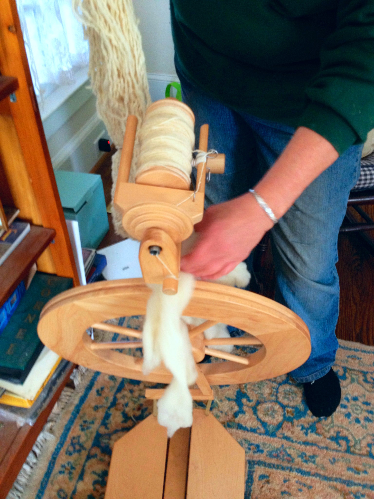 Madison County sheep farmer Jan Southers spins wool from her sheep into yarn.