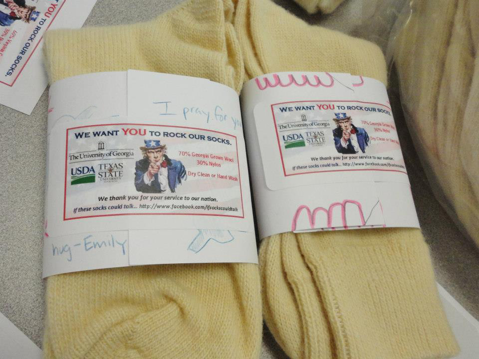 Students in the UGA College of Family and Consumer Sciences sent wool socks to soldiers in Afghanistan. The labels were designed by the Gaines Elementary School Sewing Club.