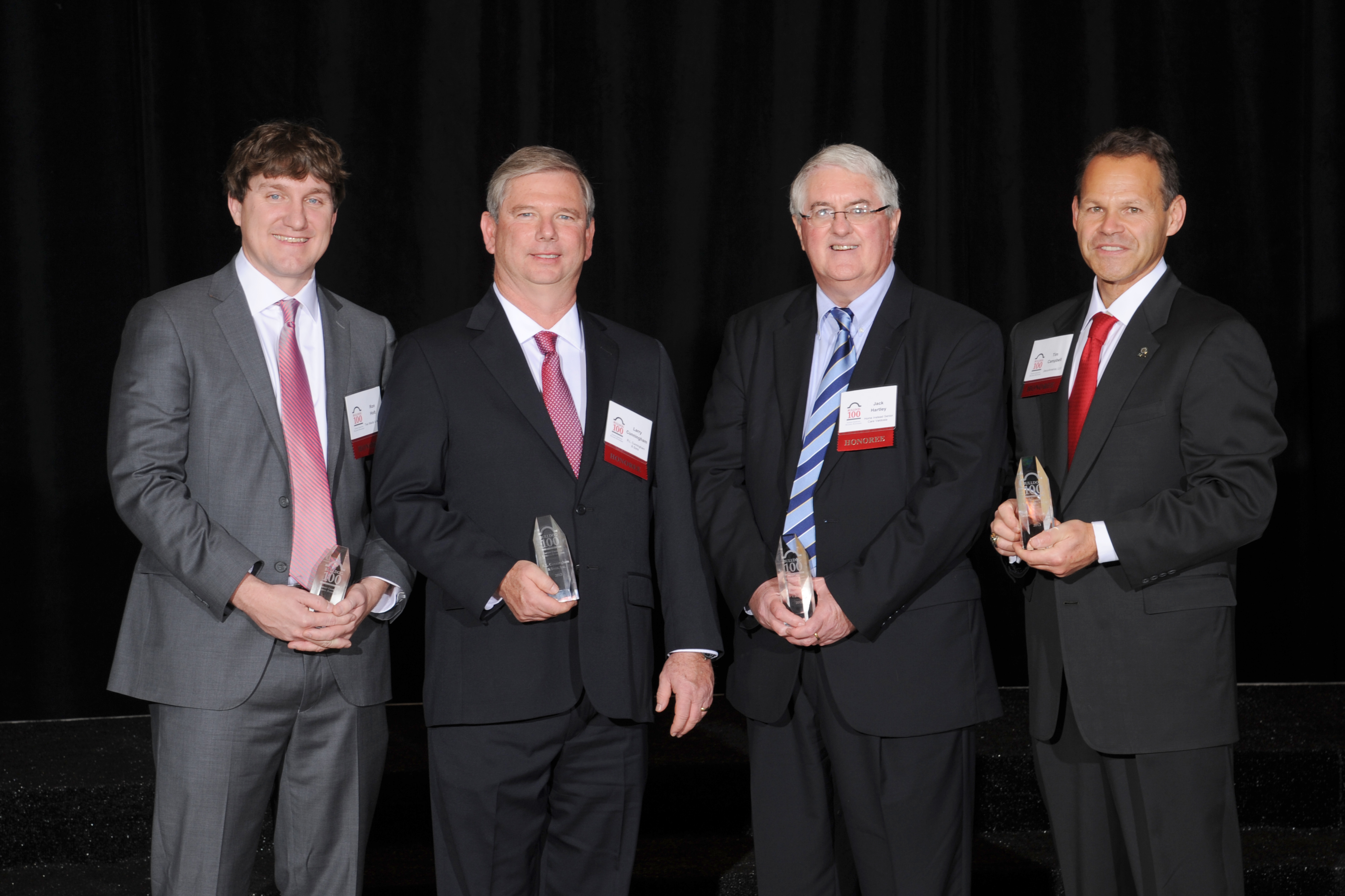 Nine University of Georgia College of Agricultural and Environmental Sciences graduates were honored on this year's Bulldog 100 list of the fastest growing businesses owned or operated by UGA alumni. Pictured at the Bulldog 100 event are four of the honorees - Ron Holt, Larry Cunningham, Jack Hartley and Timothy Campbell.