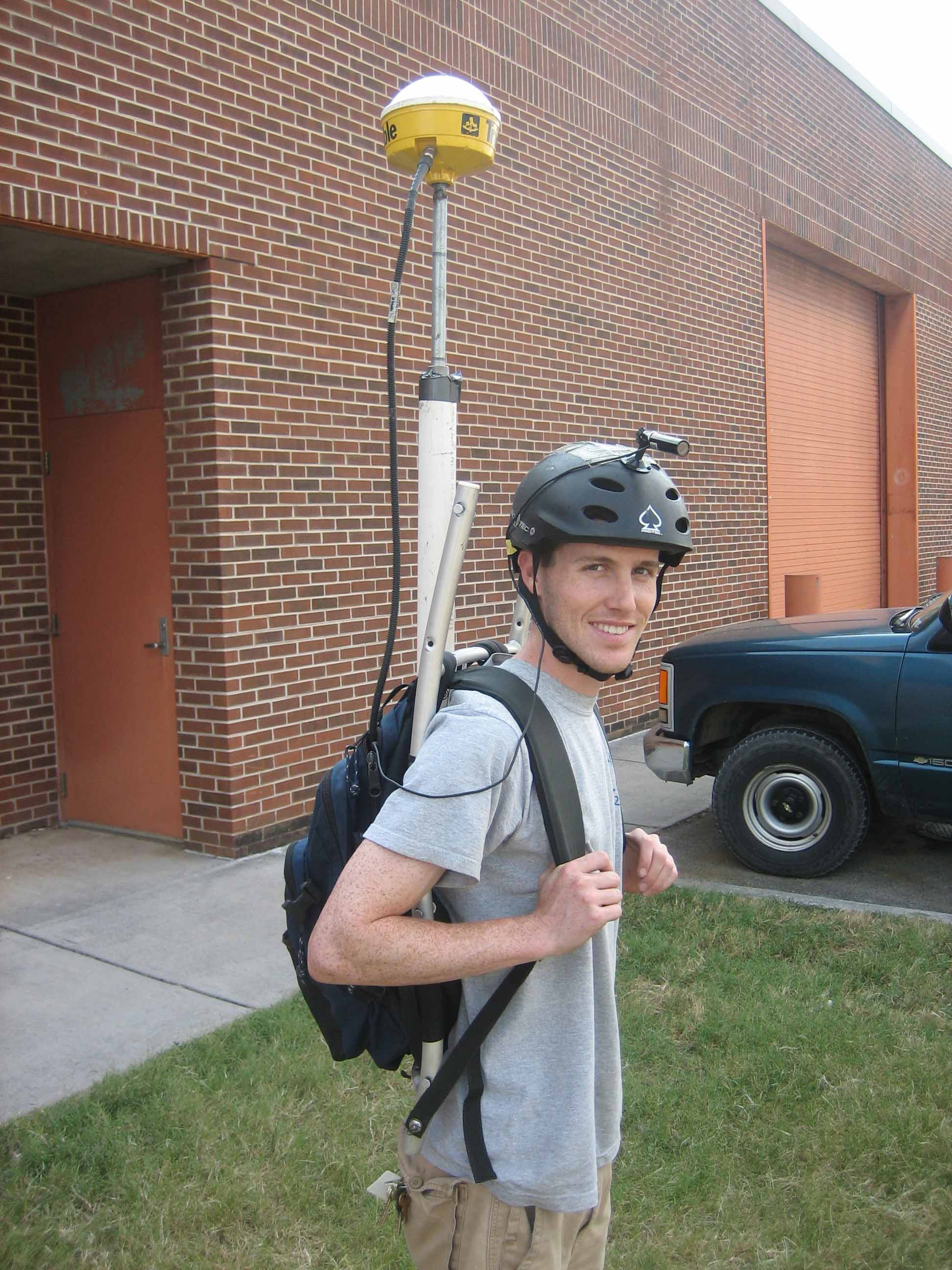 GA Environmental Engineering graduate student Jay Bevington dons GPS tracking device and a video camera for a trail mapping project he did during his undergraduate years at UGA. This project was supposed to produce a program that was like Google Street View for trails. He's currently working near Venice, Italy through the Trans Atlantic Precision Agricultural Consortium.
