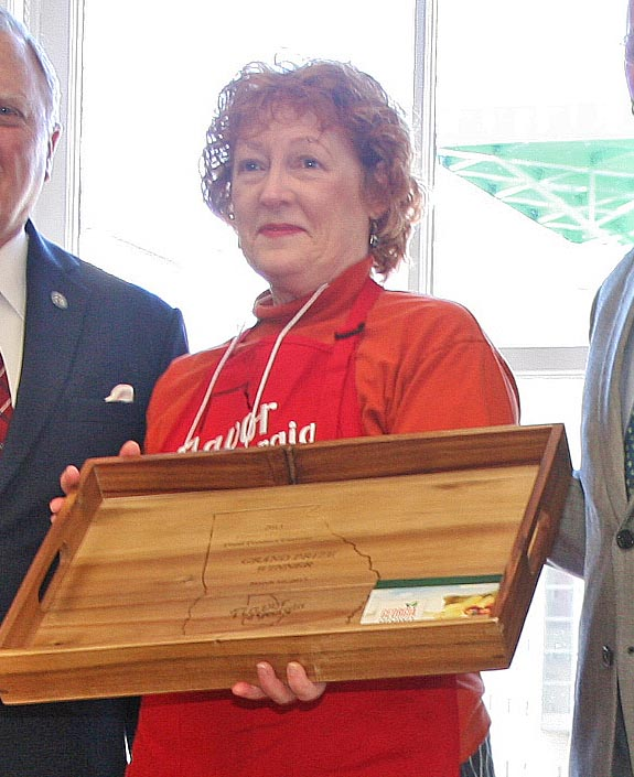 Governor Nathan Deal and Commissioner of Agriculture Gary Black present the 2013 Flavor of Georgia first prize award to Amy Stankus, owner of Chocolate South. Stankus' company Chocolate South won the first prize in the 2013 Flavor of Georgia Food Product Contest with her Georgia Peach Tea Bonbons.