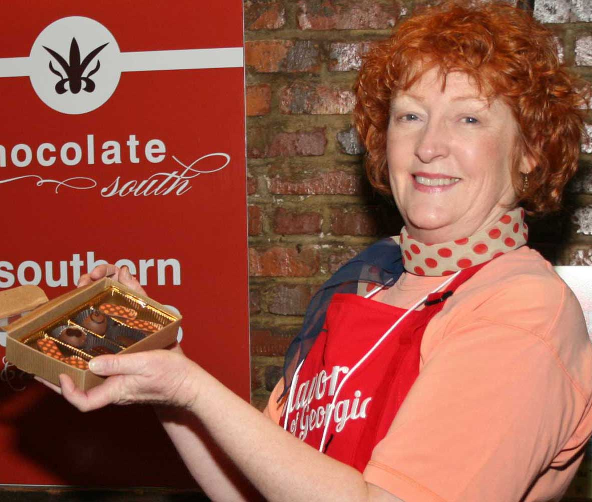 Atlanta architect and chocolatier Amy Stankus serves chocolates to the public during the Flavor of Georgia 2013 legislative reception on Monday March 11 at the Georgia Freight Depot in Atlanta. Stankus' company Chocolate South won the first prize in the 2013 Flavor of Georgia Food Product Contest.
