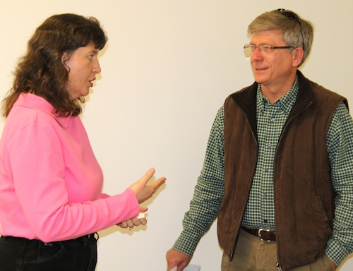 Krissa Jones, a food processing specialist with the Georgia Department of Agriculture, discusses the proposed food safety act with Bob McLeod of 4 P Farms in Wilcox County.
