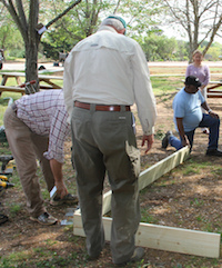 A group of Georgia Extension Master Gardener Volunteers learn to build a raised bed at a University of Georgia class in Griffin, Ga.