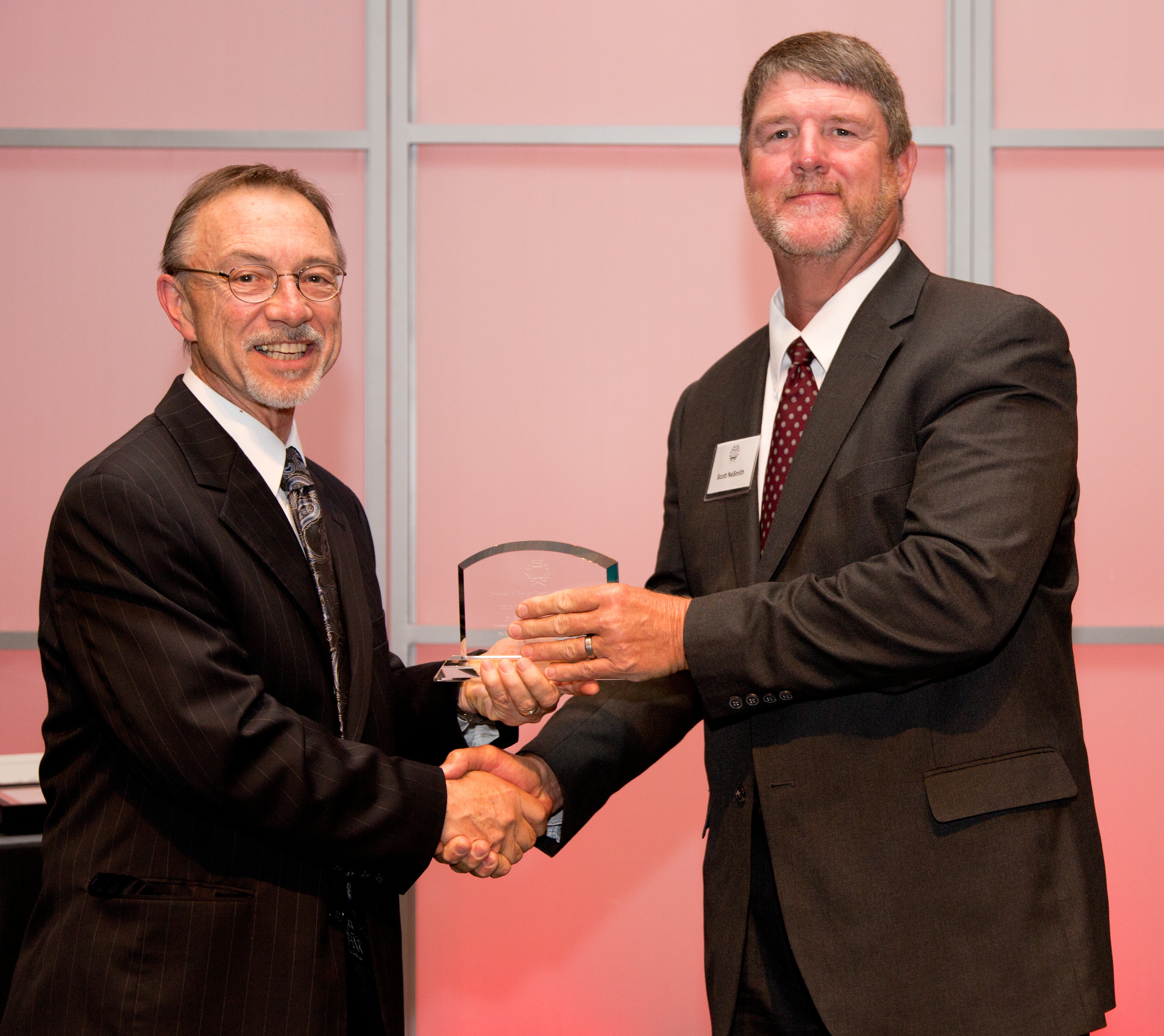 University of Georgia horticulturist Scott NeSmith (right) is shown receiving the 2013 Inventor's Award from UGA Vice President for Research David Lee.