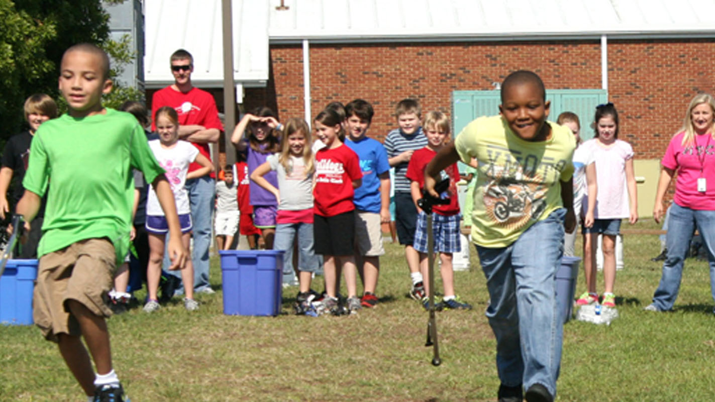 Third graders participate in a recycling relay race.