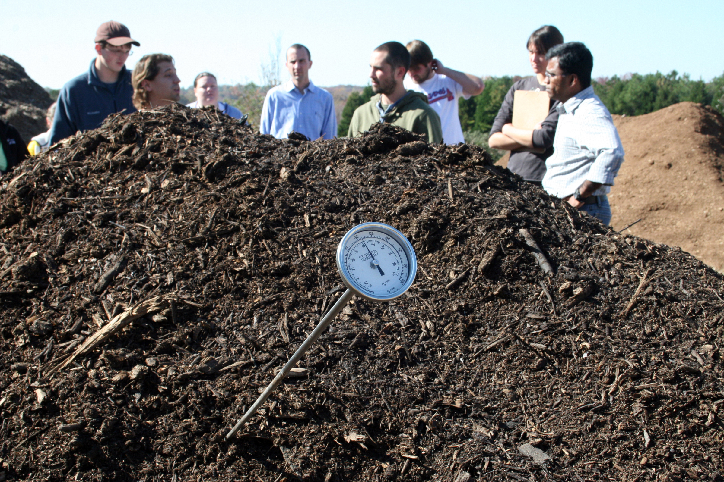 Compost adds organic matter to the soil, helping plants grow and saving landfill space.