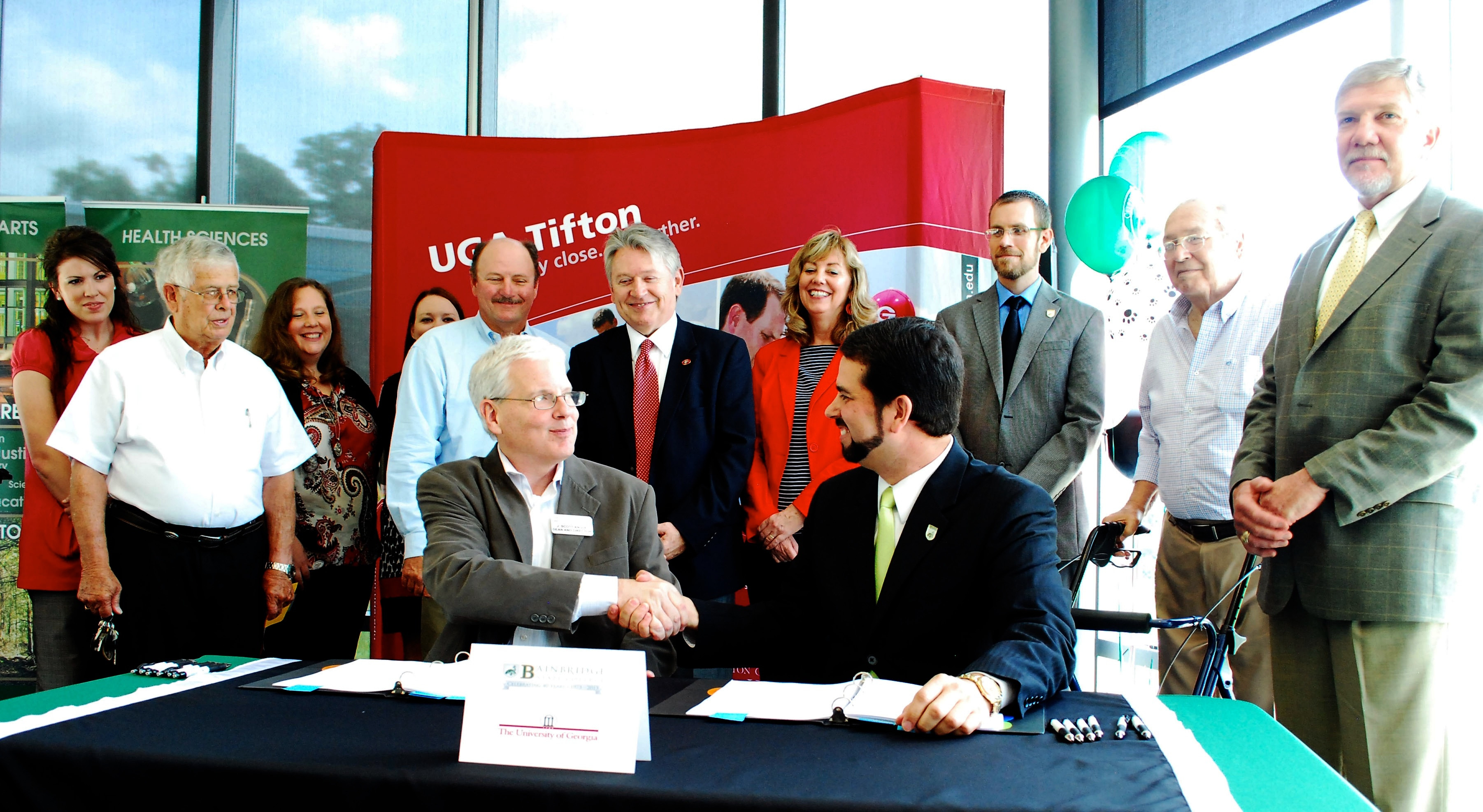 Officials from the University of Georgia College of Agricultural and Environmental Sciences and Bainbridge State University sign Memorandums of Understanding that will allow students who graduate from BSC to automatically gain acceptance into a bachelor's degree program in agriculture at the UGA campus in Tifton.