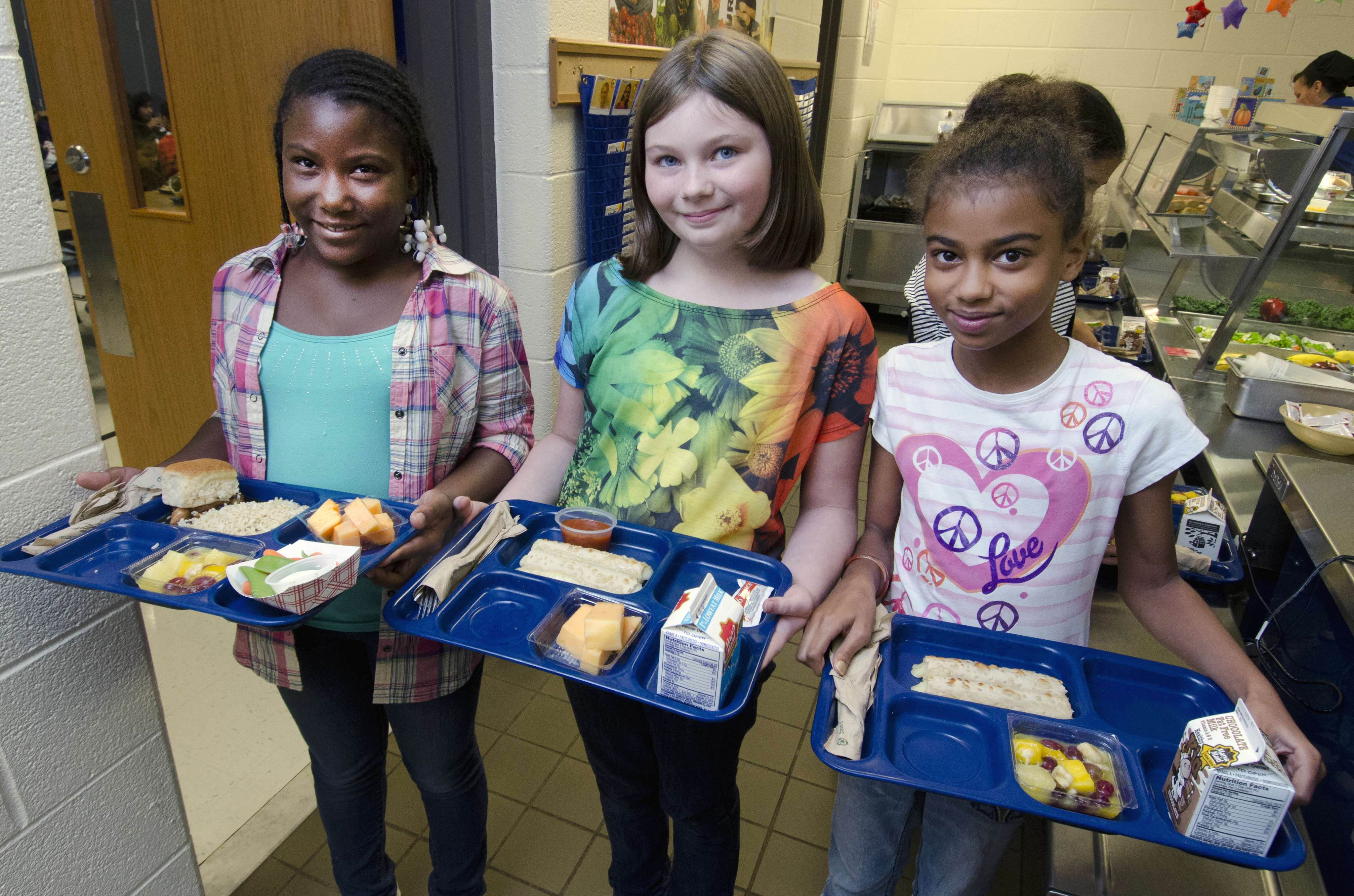 New school lunch regulations will be bringing more whole grains and less salt to cafeterias this school year.