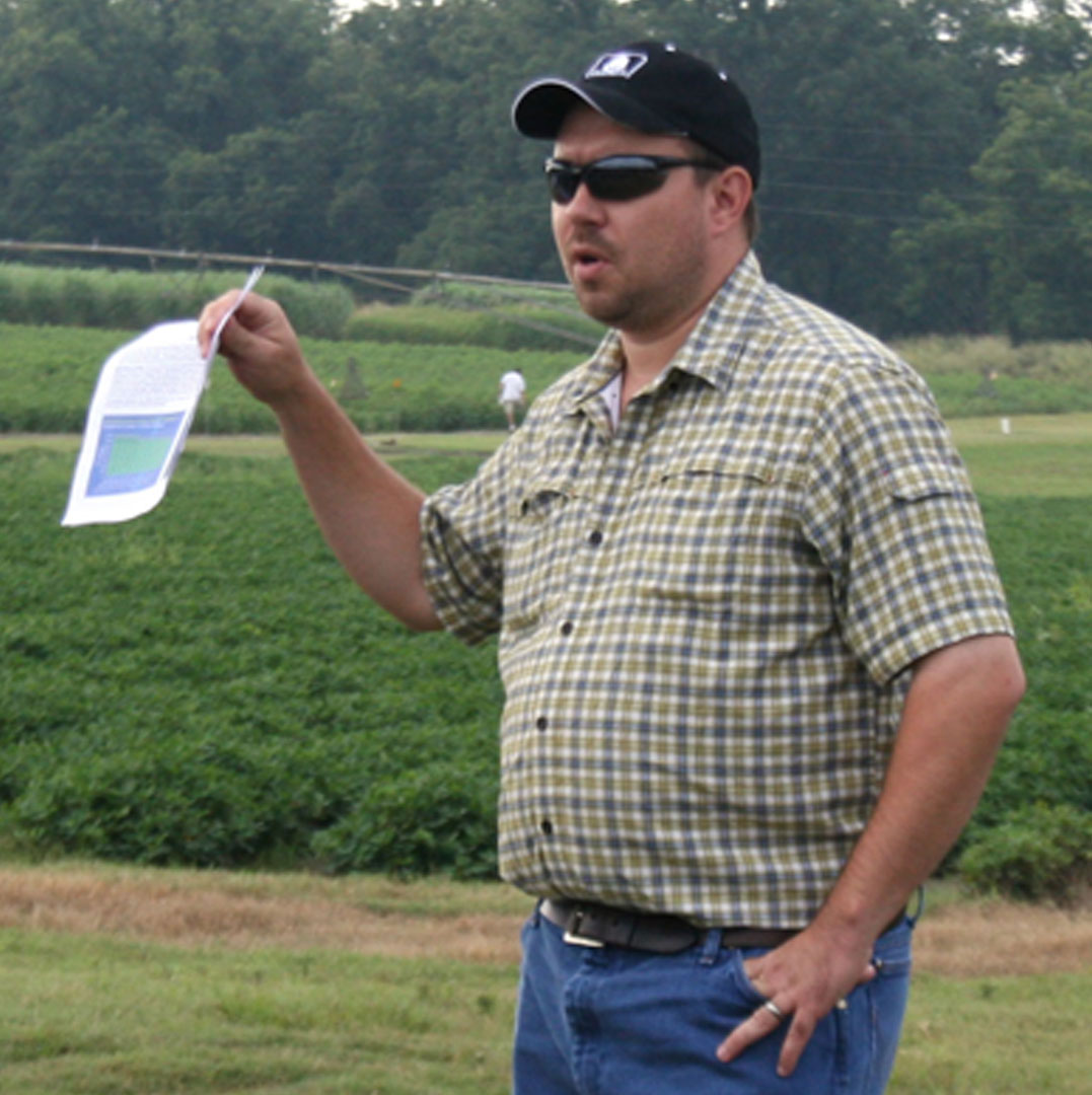 Guy Collins, an Extension cotton agronomist with the University of Georgia-Tifton campus, talks about cotton to producers and consultants at the Southeast Georgia Research and Education Center Field Day in Midville on Aug. 14.