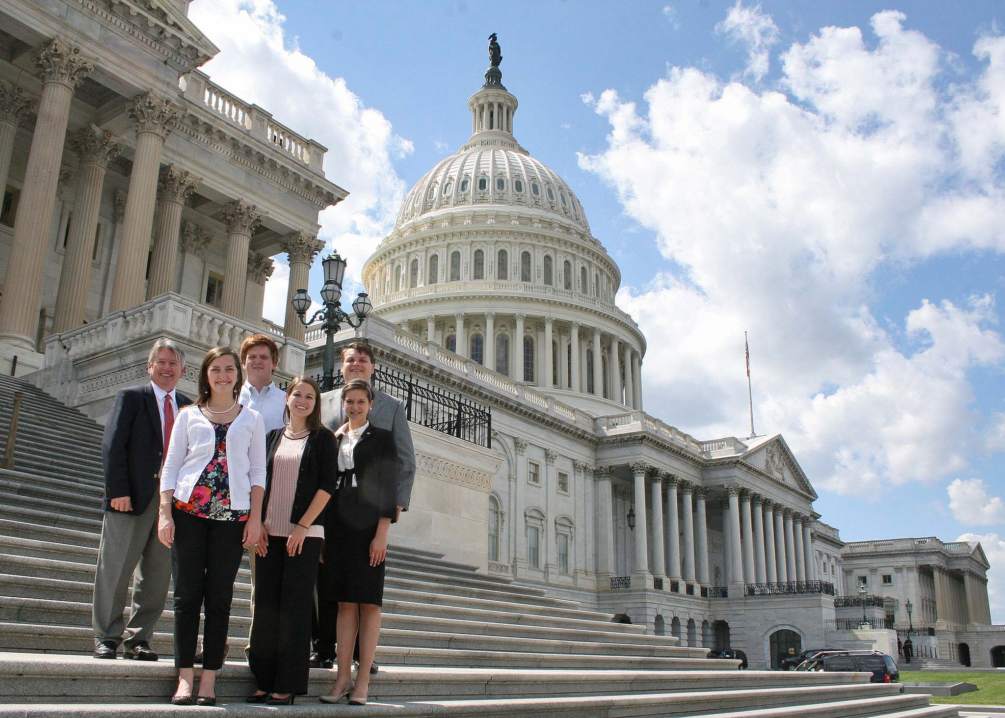 Associate Dean for Academics Josef Broder stands with CAES Agricultural D.C. Fellows Valerie Noles, Rebecca Rykard, Heather Hatzenbuhler, William Moses and Lee Lister at the capital during summer 2013.