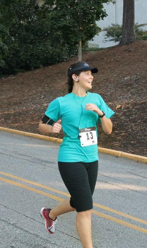 Walk Georgia Logo/WG participant Andrea Gonzalez running in a 5K