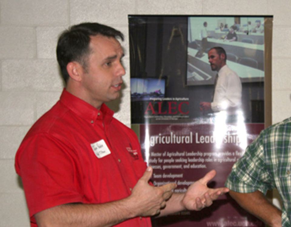 Jason Peake, an agriculture teacher at the University of Georgia Tifton Campus, talks to prospective students and family members at last week's showCAES Southeast recruiting event in Lyons on Sept. 19.