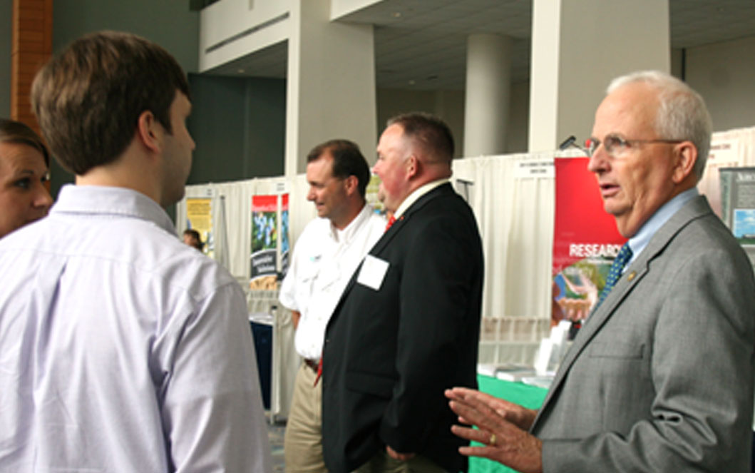 Gary Black, Georgia's Commissioner of Agriculture, speaks to a couple of attendees at last week's International Agribusiness Conference and Expo in Savannah.