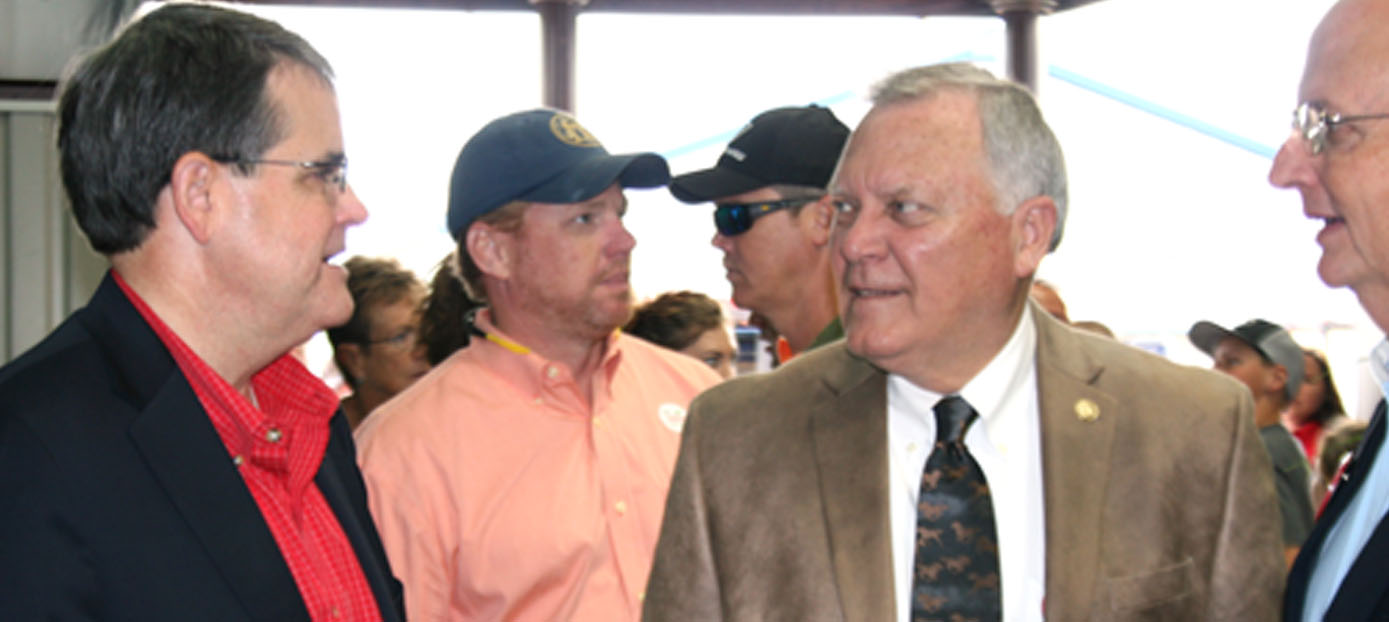 University of Georgia President Jere Morehead, left, Georgia Gov. Nathan Deal and Georgia Agricultural Commissioner Gary Black talk on Tuesday at the Sunbelt Ag Expo in Moultrie.