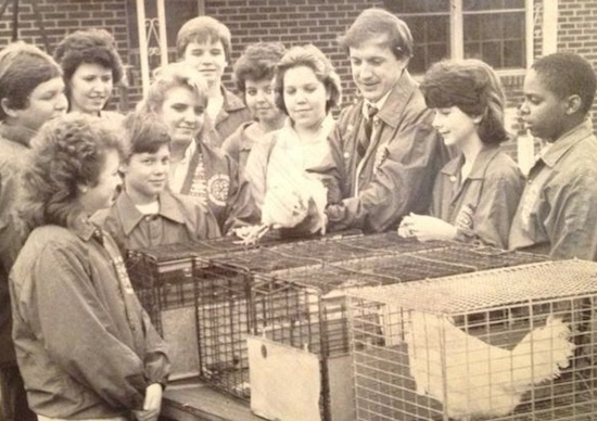 "Bo Ryles served as the 4-H agent in Clarke County (Athens). In this circa 1980's photo, he is shown teaching 4-H'ers what to look for when deciding which White Leghorn Hen had laid the most eggs. ""Every student had on a 4-H Jacket. That was a Clarke Co. 4-H tradition. When we put on the green, we were getting serious about competing,"" Ryles said."